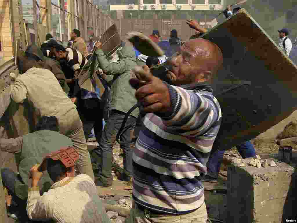 A rock flies past an opposition supporter during rioting against pro-Mubarak demonstrators near Tahrir Square.