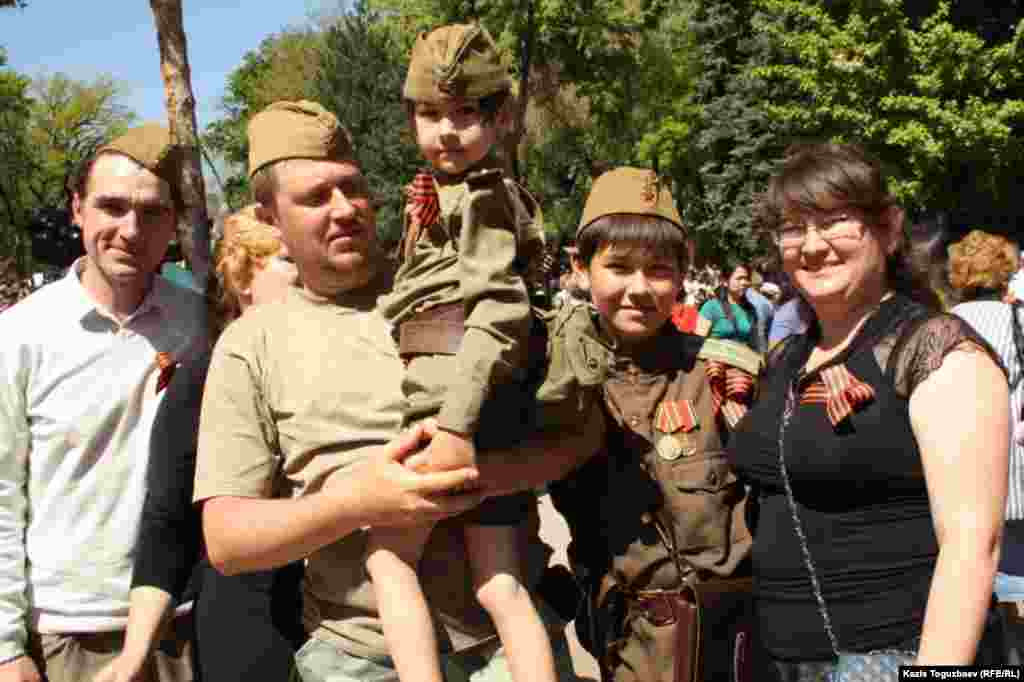 Family members wear the St. George Ribbon, a Russian symbol of military valor, in Almaty.