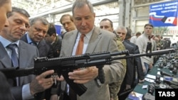Russian Deputy Prime Minister Dmitry Rogozin (center) inspecting Kalashnikov rifles earlier this year.