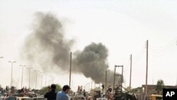 The battle between revolutionary fighters and loyalists continues along the roads of Sirte.