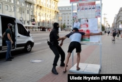 A protester is detained on Independence Avenue in Minsk on the eve of the election on August 8.