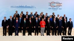 G20 leaders pose for a photo at a summit in Hamburg in July 7.