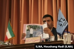 In this photo released by the Iranian Labor News Agency (ILNA), judge Abolqasem Salavati, shows a picture of a protester during Iran's post-election turmoil, at the Revolutionary Court in Tehran, Iran, Sunday, Aug. 16, 2009.