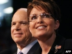 McCain stands with his controversial running mate Sarah Palin on the presidential campaign trail in August 2008.