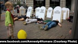 A protest in Zurich by members of Amnesty International against capital punishment in Belarus in August