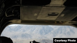 """Hope for the best, prepare for the worst."" The view from a Chinook helicopter over Ghazni Province. (Photo by Stephen McInerney)"