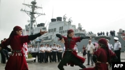 "Georgian artists welcome the ""USS Stout"" in Georgia's Black Sea port of Batumi."