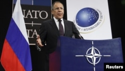 Russian Foreign Minister Sergei Lavrov holds a news conference after a NATO-Russia foreign ministers meeting at the military alliance's headquarters in Brussels on December 8.
