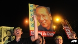 Protesters demonstrate for Liu Xiaobo to be freed near the China Liason Office in Hong Kong on October 8.