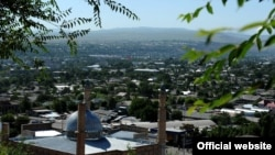 Kyrgyzstan -- A view of Souleymane mountain with new central mosque, Osh, 11Jul2012