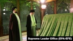 Iranian supreme leader Ayatollah Ali Khamenei (C) and Khomeini's grandson Hassan Khomeini (L) pray inside the shrine of late Iranian Supreme Leader Ayatollah Ruhollah Khomeini. FILE PHOTO