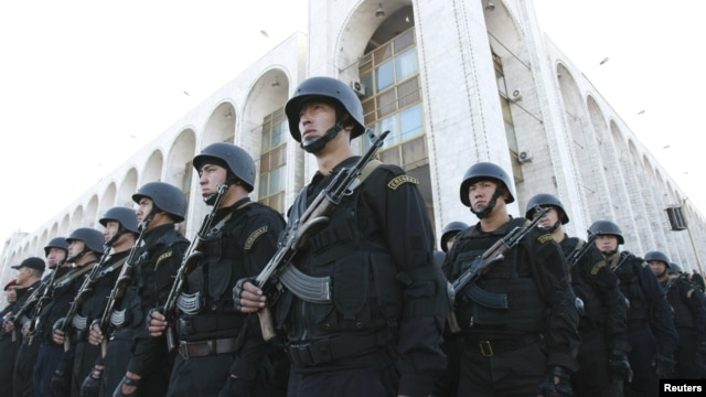 Kyrgyz security forces in Bishkek stand in formation during preparations for heightened security measures ahead of a presidential election in the Central Asian country in 2011.
