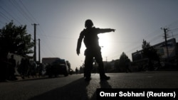 Afghan police arrive at the site of a suicide bomb attack in Kabul on August 15.