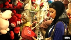 Girl checking Valentines Day gifts at a shop in Tehran. FILE PHOTO.