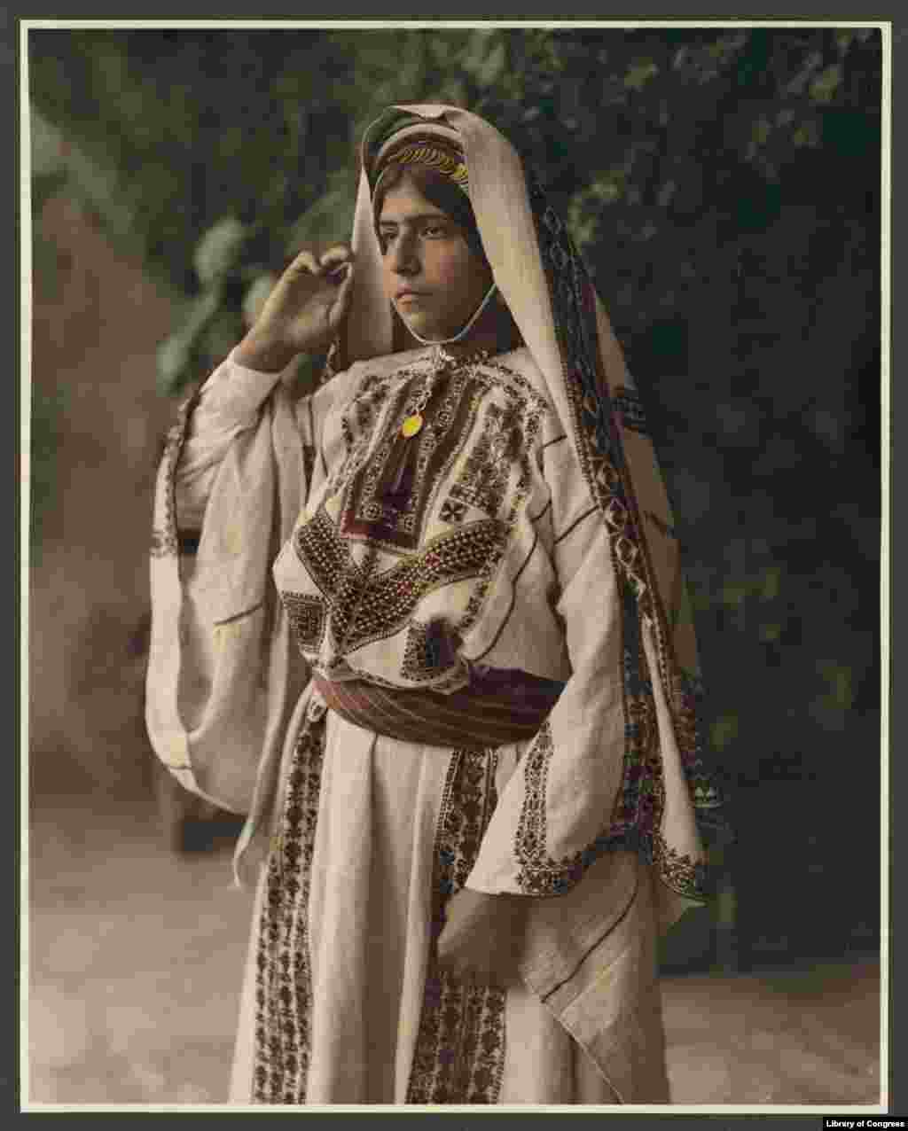 A woman in embroidered costume in Ramallah, now the headquarters of the Palestinian Authority