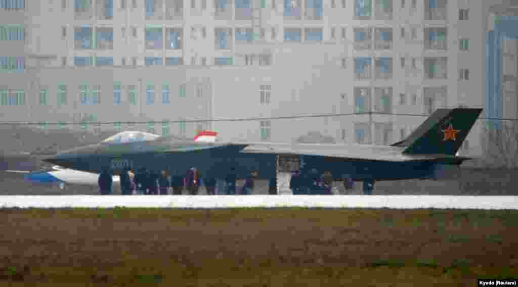 "Lynette Nusbacher, a strategist and former British intelligence officer, told RFE/RL the J-20's engines leave China on the bench. ""When China learns to make a good military aircraft engine, they'll be in the game. Until then, they're bystanders."""