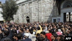 Hundreds of people march from the Omayyed mosque in the center of Damascus.