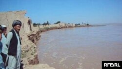 Village elder Hadji Khaleq inspects the ruins of a home in Yaz Ariq Dinar destroyed by the advancing Amu Darya river