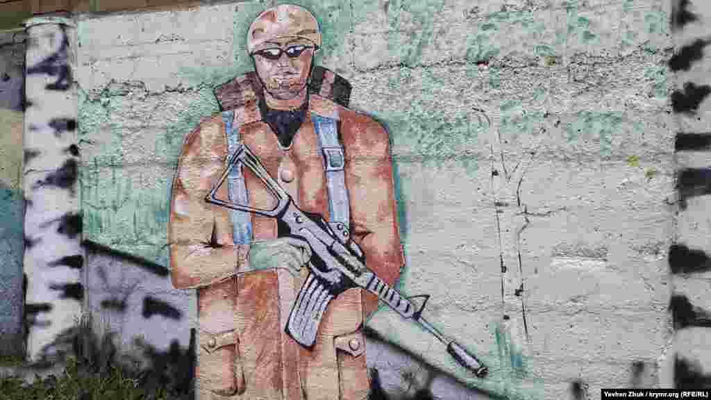 На малюнку зображений американський солдат серед берізок