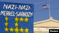 A banner in front of the Greek parliament during a rally against austerity measures in Athens