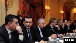 Opposition leaders (from 2nd left) Irakli Alasania, Davit Gamkrelidze, Davit Usupashvili, and Levan Gachechiladze meeting in a Tbilisi hotel last year.