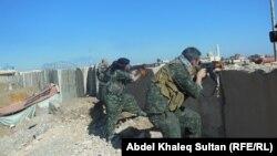 Իրաք - Քուրդ աշխարհազորայինները «Իսլամական պետության» զինյալների հետ մարտերի ժամանակ, նոյեմբեր, 2014թ․