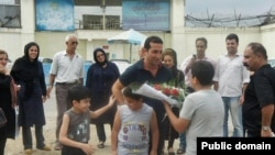 Iranian pastor Youcef Nadarkhani meets his family upon being released from prison on September 8.