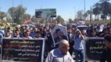 صحفيون يحتجون على مقتل مدير مكتب اذاعة العراق الحر في بغداد محمد الشمري في آذار 2014