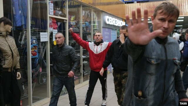 Groups of young men were said to have initiated the violence at a shopping center in the Moscow neighborhood of Biryulevo, smashing windows and overturning cars but apparently not causing any fatalities.