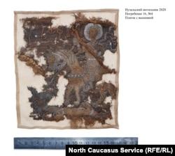 Платок с изображением Георгия Победоносца, найденный при раскопках в селе Нузал