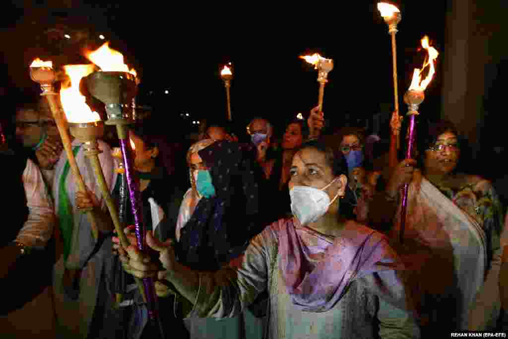 People also carried torches in Karachi as they marked the country's 73rd anniversary.