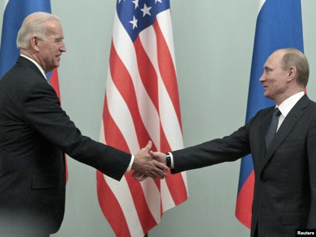 Then-Russian Prime Minister Vladimir Putin (right) meets with then-U.S. Vice President Joe Biden in Moscow in March 2011.