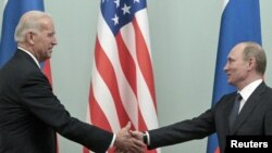Prime Minister Vladimir Putin (right) meets with U.S. Vice President Joe Biden in Moscow.