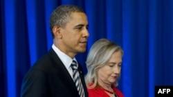 Барак Обама (слева) и Хиллари Клинтон