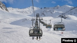 Ski lifts on an Austrian ski slope.