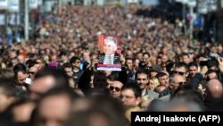 More than 15,000 people marched in Belgrade on March 12 in silence to mark the 10th anniversary of the assassination of Serbian Prime Minister Zoran Djindjic.