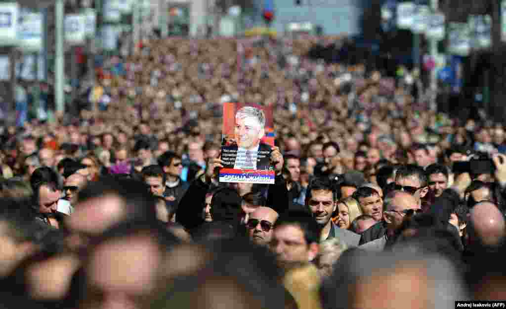 More than 15,000 people march in silence to mark the 10th anniversary of the murder of Serbian Prime Minister Zoran Djindjic in Belgrade. Djindjic, the first democratically elected prime minister in postcommunist Serbia, was shot and killed by a sniper on March 12, 2003. (AFP/Andrej Isakovic)