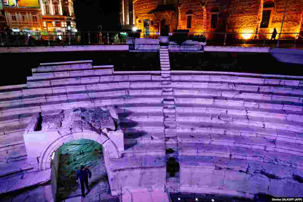 An ancient Roman stadium in Plovdiv is illuminated at night. The city has architectural landmarks from theThracian, Greek, Roman, Byzantine, and Ottoman eras, among others.
