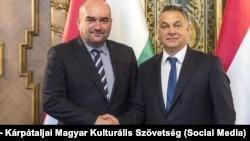 Vasyl Brenzovych (left) with Hungarian Prime Minister Viktor Orban