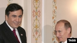 Saakashvili (left) and Putin -- twins under the skin?