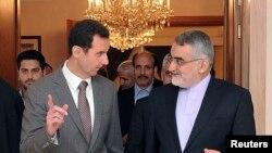 علاءالدین بروجردی در کنار بشار اسد