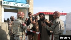 Pakistani soldiers check the identity of citizens returning from Afghanistan at the border crossing in Chaman on March 7.