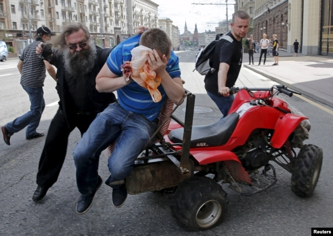 Antigay protesters attack a gay-rights activist during an LGBT rally in central Moscow in May 2015.