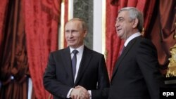RUSSIA -- Russian President Vladimir Putin (L) welcomes Armenian President Serzh Sargsyan (R) in Kremlin, Moscow, 23 December 2014.