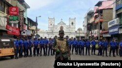 Sri Lankan military stand guard in front of the Kochchikade church after an explosion in Colombo