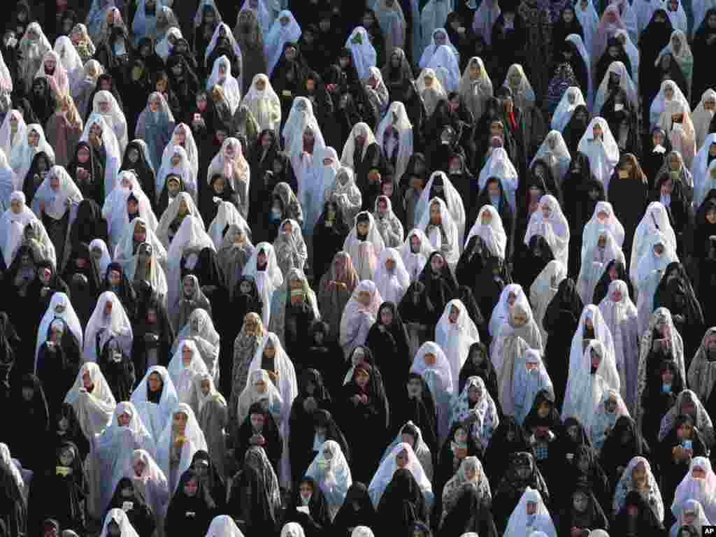 Women perform their Eid al-Fitr prayer on Imam Square in the Iranian city of Isfahan. (Photo by Vahid Salemi for AP)