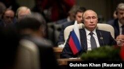 Russian President Vladimir Putin looks on during the BRICS summit in Johannesburg on July 26.
