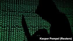 تصویر یک هکر که جنبه تزئینی با گزارش ذیل دارد