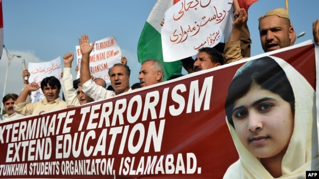 Pakistan -- Demonstrators chant slogans during a protest against the assassination attempt by the Taliban on child activist Malala Yousafzai in Islamabad, 16Oct2012
