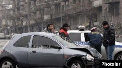 Armenia -- Traffic police investigate a car collision in Yerevan, 11Jan2011.